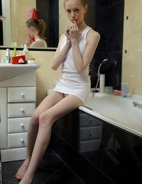 Skinny teen taking a bath